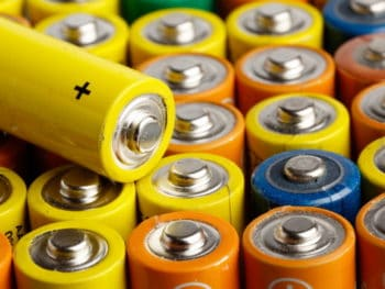 Rows of multicoloured AA batteries