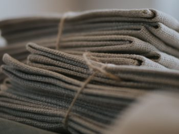 Folded woven cloth tied in bundles