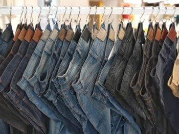 Jeans hanging on a clothing rack