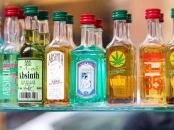 Bottles of spirits on a glass shelf